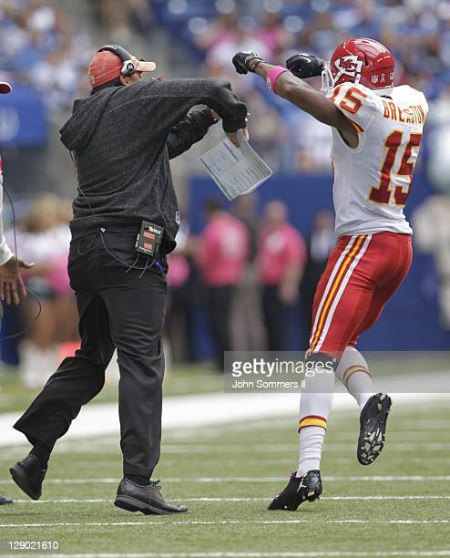 Todd Haley head coach of the Kansas City Chiefs' celebrates the touchdown catch by Steve Breaston of the Kansas City Chiefs' during the second half...