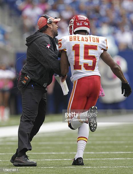 Todd Haley head coach of the Kansas City Chiefs celebrates the touchdown catch by Steve Breaston of the Kansas City Chiefs' during the second half of...