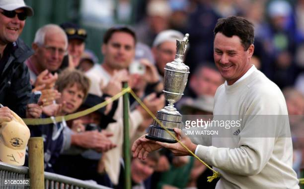 Todd Hamilton of the US shows the Claret Jug to members of the gallery after winning a play off by one stroke against Ernie Els of South Africa at...
