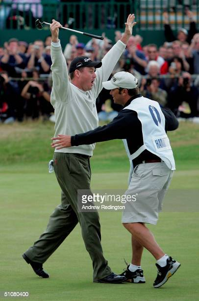 Todd Hamilton of the USA celebrates victory with his caddy Ron Levin on the 18th green after a playoff in the 133rd Open Championship at the Royal...