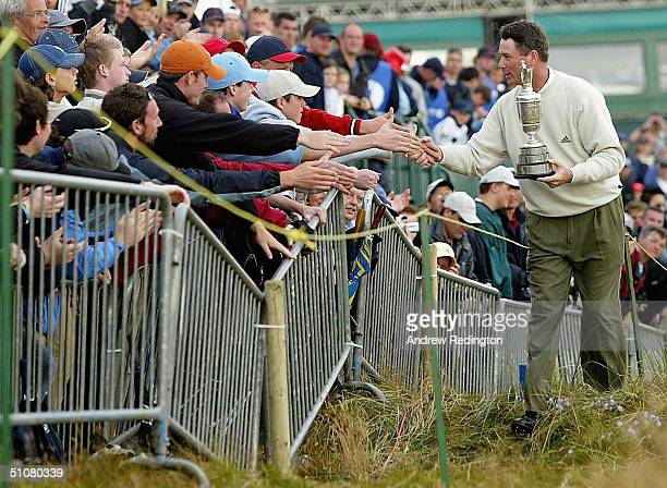 Todd Hamilton of USA is congratulated by the crowd after securing victory in the 133rd Open Championship following a playoff at the Royal Troon Golf...