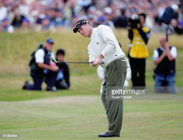 Todd Hamilton of USA plays onto the 18th green with a 'rescue' club during the playoff following the final round of the 133rd Open Championship at...