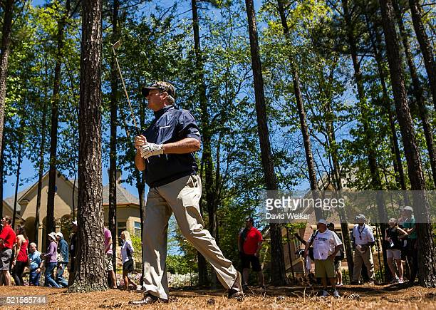 Todd Hamilton walks out from the trees after hitting his third shot on the fourth hole during the second round of the Mitsubishi Electric Classic at...