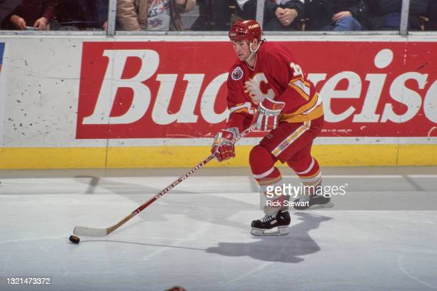Todd Harkins, Center for the Calgary Flames in motion on the ice during the NHL Eastern Conference Northeast Division game against the Buffalo Sabres...