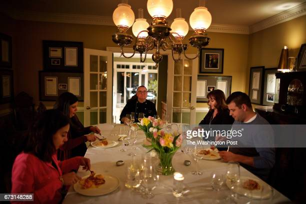 MCLEAN VIRGINIA Todd Hauptli and his guests from left to right Romie Stefanelli Marjorie MeekBradley Kathy Hauptli and Nick Stefanelli dine on the...