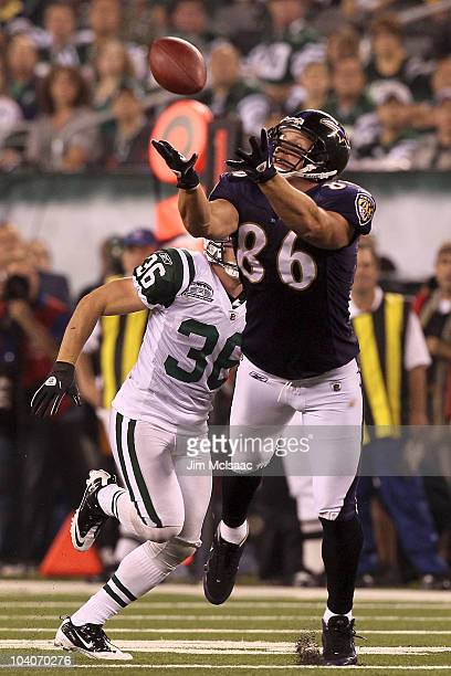 Todd Heap of the Baltimore Ravens catches a pass over Jim Leonhard of the New York Jets during their home opener at the New Meadowlands Stadium on...