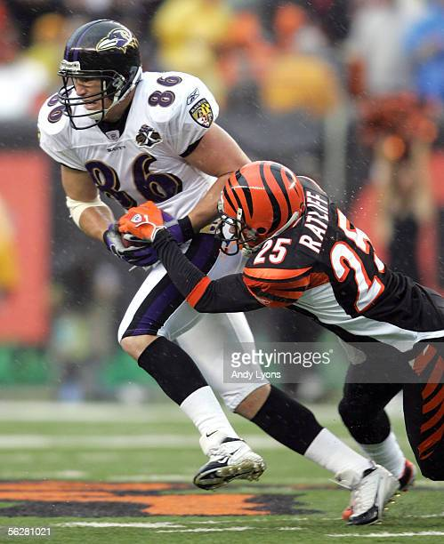 Todd Heap of the Baltimore Ravens is tackled by Keiwan Ratliff the Cincinnati Bengals on November 27, 2005 at Paul Brown Stadium in Cincinnati, Ohio.