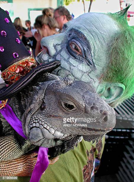 Todd Heins looks back at Miss Trouble a fiveyearold Mexican green iguana entered in the Pet/Owner LookAlike division of the Fantasy Fest Pet...