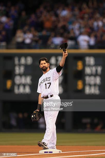 Todd Helton of the Colorado Rockies acknowledges the crowds standing ovation as he takes the field to face the Boston Red Sox for his final home game...
