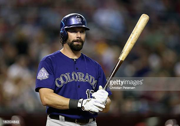 Todd Helton of the Colorado Rockies bats against the Arizona Diamondbacks during the MLB game at Chase Field on September 13 2013 in Phoenix Arizona