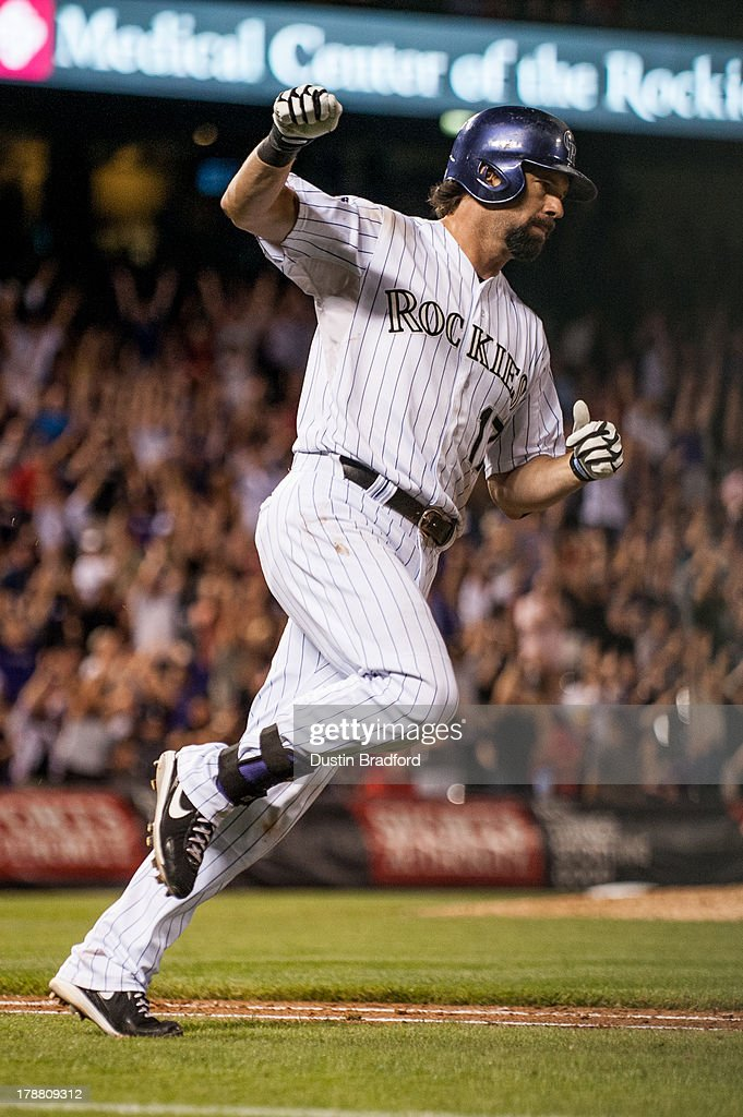 Todd Helton #17 of the Colorado Rockies celebrates his second three-run home run of the game for his 2,499th career hit in the seventh inning of a game against the Cincinnati Reds at Coors Field on August 30, 2013 in Denver, Colorado. The Rockies beat the Reds 9-6.