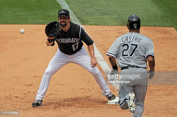 Todd Helton of the Colorado Rockies gets a put out on Ramon Castro of the Chicago White Sox during Interleague play at Coors Field on June 30 2011 in...