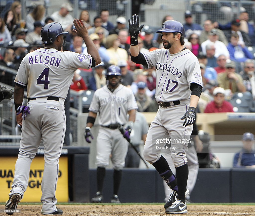 Todd Helton #17 of the Colorado Rockies is congratulated by Chris Nelson #4 of the Colorado Rockies after he hit a two-run homer during the seventh inning of a baseball game against the San Diego Padres at Petco Park on April 14, 2013 in San Diego, California. The Rockies won 2-1.