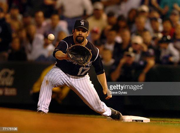 Todd Helton of the Colorado Rockies prepares to catch a throw to him to make a put out against the San Diego Padres in the wildcard baseball playoff...