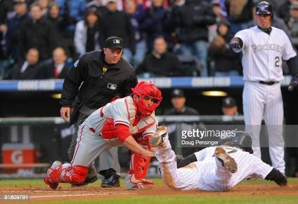 Todd Helton of the Colorado Rockies scores under the tag by Carlos Ruiz of the Philadelphia Phillies in the bottom of the sixth inning in Game Four...