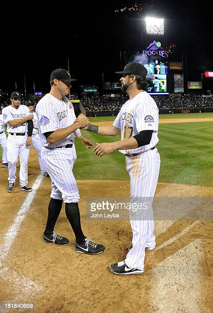 Todd Helton of the Colorado Rockies shakes hands with Matt Belisle of the Colorado Rockies at the end of the game against the Boston Red Sox...