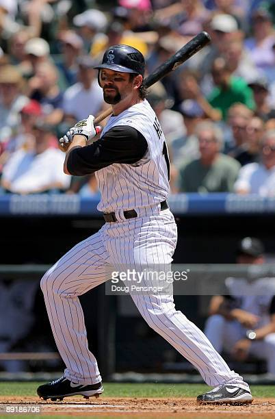 Todd Helton of the Colorado Rockies singles to left field off of starting pitcher John Garland of the Arizona Diamondbacks in the first inning during...