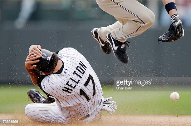 Todd Helton of the Colorado Rockies steals second base against Mark Loretta of the San Diego Padres in the sixth inning at Coors Field on opening day...