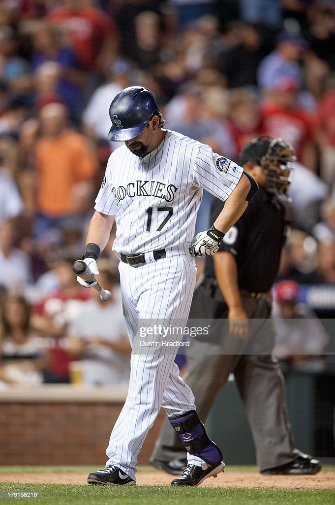 Todd Helton #17 of the Colorado Rockies walks back to the dugout after striking out leading off the seventh inning of a game against the Cincinnati Reds at Coors Field on August 31, 2013 in Denver, Colorado. The Reds beat the Rockies 8-3.