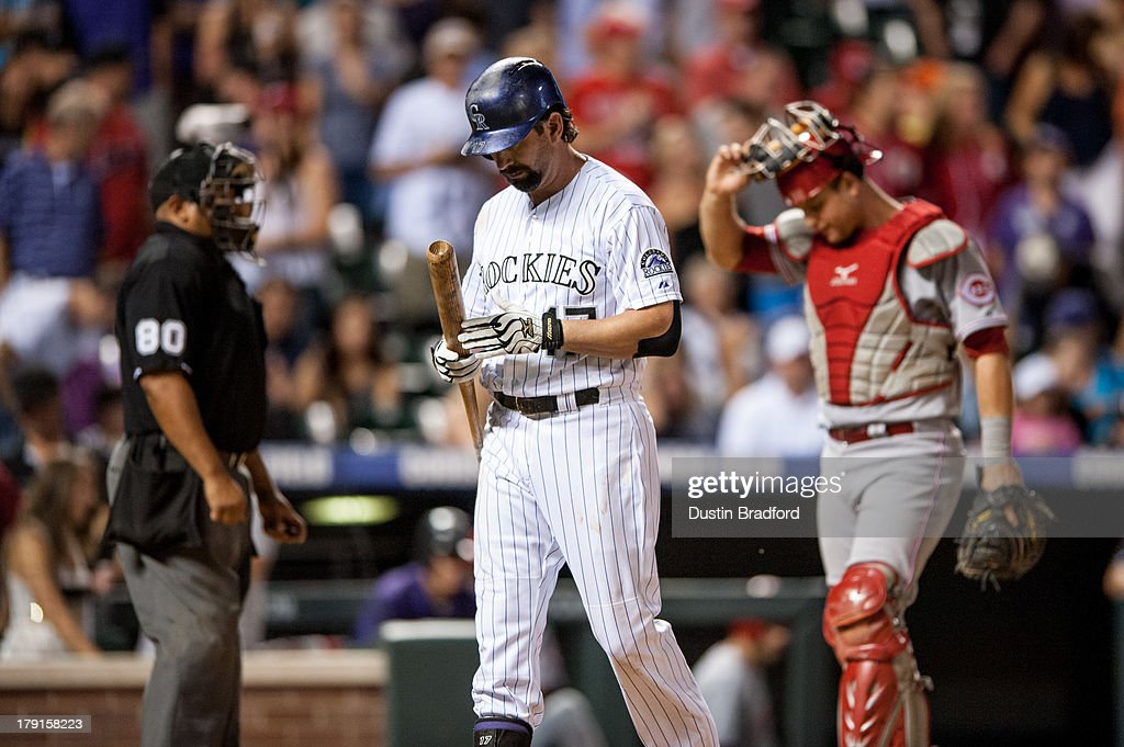 Todd Helton #17 of the Colorado Rockies walks back to the dugout after striking out in the ninth inning of a game against the Cincinnati Reds at Coors Field on August 31, 2013 in Denver, Colorado. The Reds beat the Rockies 8-3.