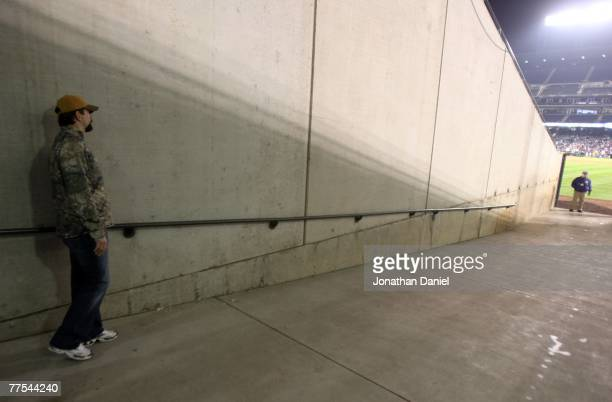 Todd Helton of the Colorado Rockies watches from the tunnel as the Boston Red Sox celebrate after winning Game Four by a score of the 4-3 to win the...