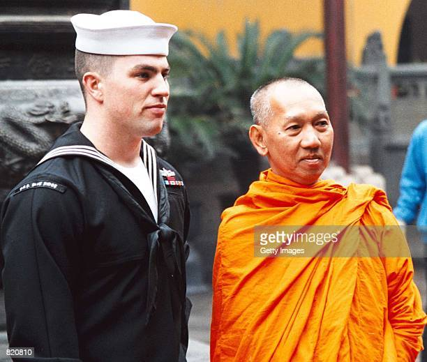 Todd Jensen of Littleton Colo observes the sights of the Temple of the Jade Buddha with a Buddhist Monk March 24 2001 in Shanghai Sailors from the US...