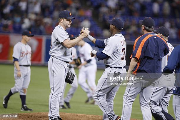 Todd Jones of the Detroit Tigers celebrates with Marcus Thames the Tigers' win and his 300th career save after a game against the Minnesota Twins at...