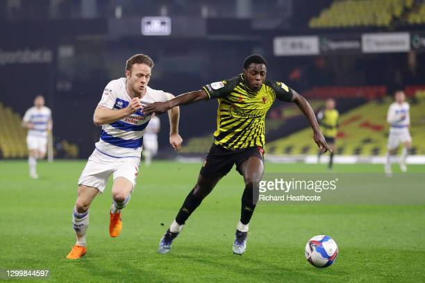 Todd Kane of Queens Park Rangers battles for possession with Jeremy Ngakia of Watford FC during the Sky Bet Championship match between Watford and...