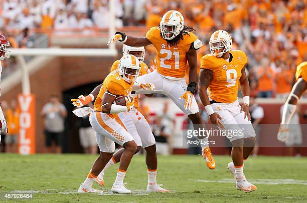 Todd Kelly Jr celebrates with Jalen Reeves-Maybin of the Tennessee Volunteers after Kelly intercepted a pass against the Oklahoma Sooners during the...