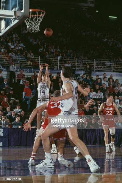 Todd Leslie, Guard for the Northwestern University Wildcats makes a 3 point shot during the NCAA Big-10 Conference college basketball game against...