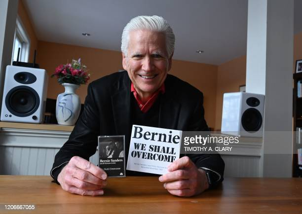Todd Lockwood at his Burlington Vermont home March 4 holds a CD and tape of the folk album that he produced called Bernie We Shall Overcome recorded...