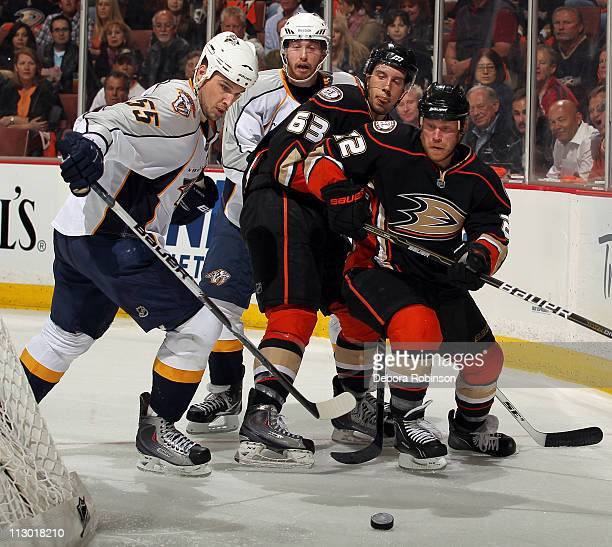 Todd Marchant and Nick Bonino of the Anaheim Ducks battle for the puck against Shane O'Brien of the Nashville Predators in Game Five of the Western...
