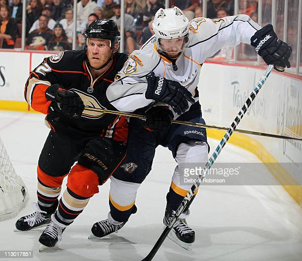 Todd Marchant of the Anaheim Ducks battles against Colin Wilson of the Nashville Predators in Game Five of the Western Conference Quarterfinals...