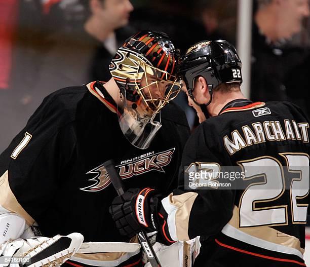 Todd Marchant of the Anaheim Ducks congratulates Anaheim Ducks goalie Jonas Hiller for his third NHL shutout against the Phoenix Coyotes on January 4...