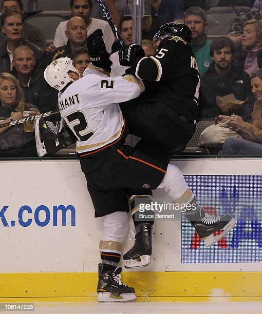 Todd Marchant of the Anaheim Ducks hits Matt Niskanen of the Dallas Stars at the American Airlines Center on October 26 2010 in Dallas Texas