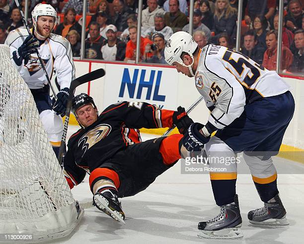 Todd Marchant of the Anaheim Ducks is checked by Shane O'Brien of the Nashville Predators in Game Five of the Western Conference Quarterfinals during...
