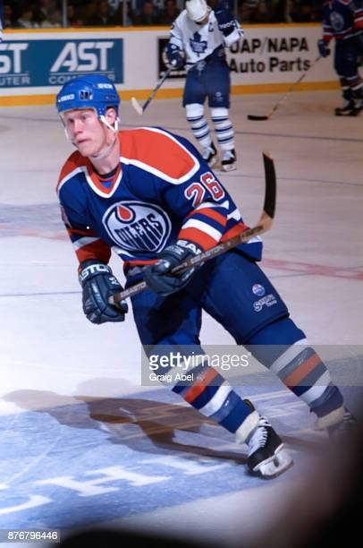 Todd Marchant of the Edmonton Oilers skates against the Toronto Maple Leafs during NHL game action on December 23 1995 at Maple Leaf Gardens in...