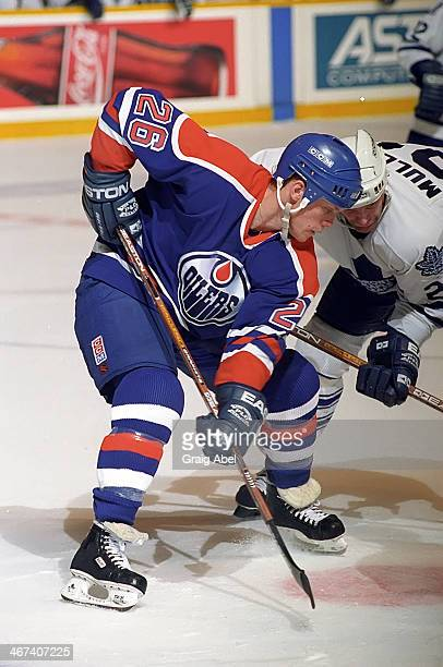 Todd Marchant of the Edmonton Oilers takes the draw against the Toronto Maple Leafs on April 13 1996 at Maple Leaf Gardens in Toronto Ontario Canada