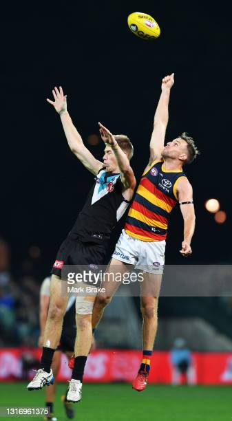 Todd Marshall of Port Adelaide spoiled by Brodie Smith of the Crows during the round eight AFL match between the Port Adelaide Power and the Adelaide...