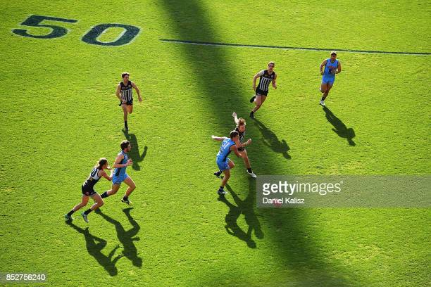 Todd Marshall of the Magpies competes for the ball with Rune Gilfoy during the SANFL Grand Final match between Port Adelaide and Sturt at AAMI...
