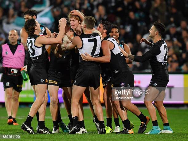 Todd Marshall of the Power celebrates with his team mates after kicking his first goal in AFL during the round 23 AFL match between the Port Adelaide...