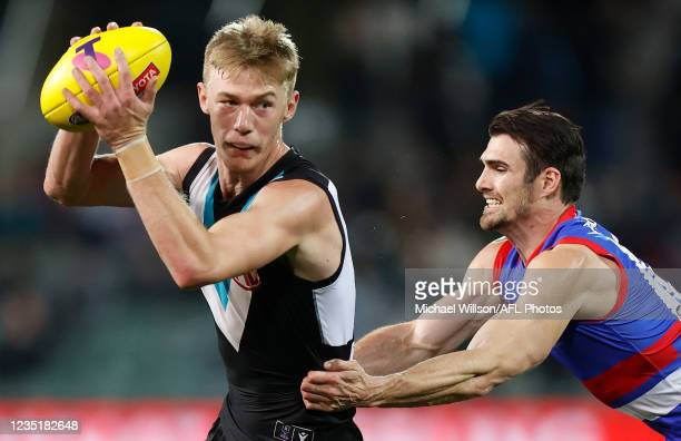 Todd Marshall of the Power is tackled by Easton Wood of the Bulldogs during the 2021 AFL Second Preliminary Final match between the Port Adelaide...