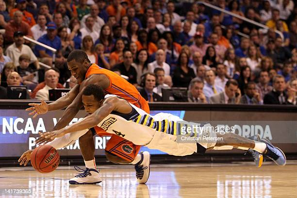 Todd Mayo of the Marquette Golden Eagles and Erving Walker of the Florida Gators go after a loose ball in the second half during the 2012 NCAA Men's...