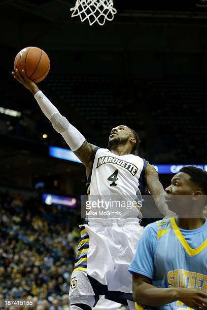 Todd Mayo of the Marquette Golden Eagles drives to the hoop in the first half of play against the Southern Jaguars at BMO Harris Bradley Center on...