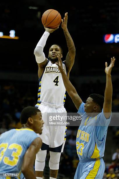 Todd Mayo of the Marquette Golden Eagles pulls up for a two pointer in the first half of action against the Southern Jaguars at BMO Harris Bradley...