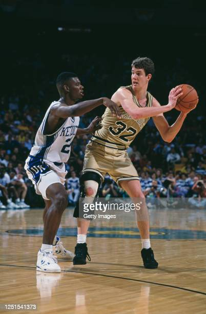 Todd Milholland, Center for the Vanderbilt University Commodores and Jamal Mashburn, Forward for the University of Kentucky Wildcats during their...