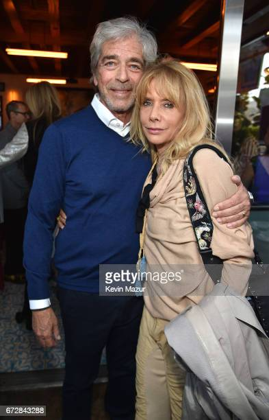 Todd Morgan and Rosanna Arquette attend Barbra Streisand's 75th birthday at Cafe Habana on April 24 2017 in Malibu California