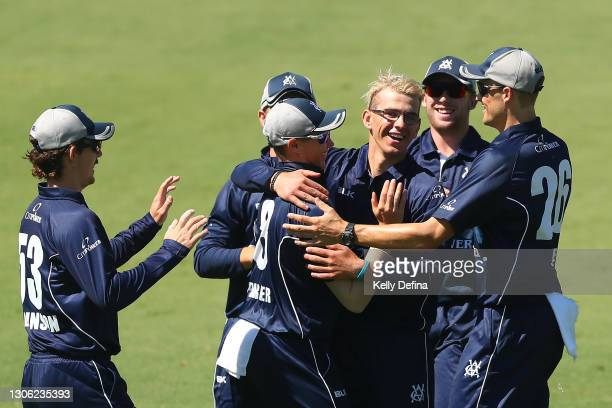 Todd Murphy of Victoria and team mates celebrate the dismissal of Tim Paine of Tasmania during the Marsh One Day Cup match between Victoria and...