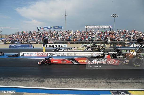 Todd near lane defeats Brittany Force to capture the Top Fuel title during the MOPAR Mile High Nationals July 20, 2014 at Bandimere Speedway.