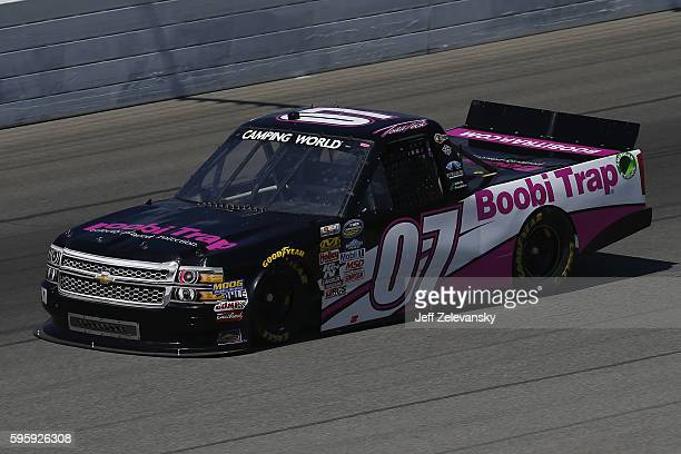 Todd Peck driver of the BoobiTrapcom Chevrolet drives during practice for the NASCAR Camping World Truck Series Careers for Veterans 200 at Michigan...